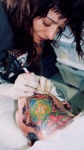 working female tattoo artist