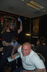 caine from spider monkey tattooing epically