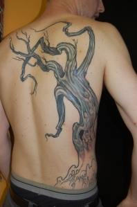 creepy tree tattoo