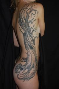 tree tattoo ribs
