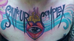 eye tattoo with lettering on chest