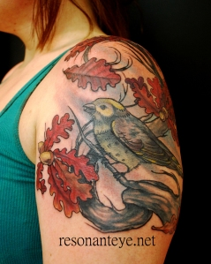 bird with autumn leaves tattoo
