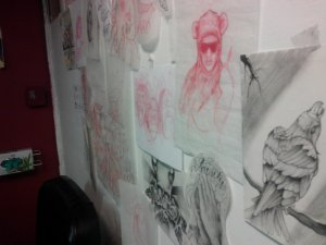 drawings on Chad's wall in his station