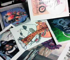 making prints! the burning church skull, and green lady are art  by http://codybrigan.com